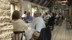 People Dining in a rustic barn at an opera festival