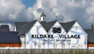 Kildare Shopping Village Main Building on a cloudy day