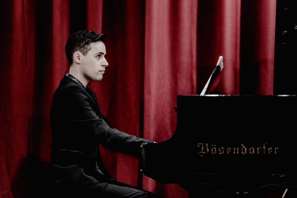 Niall Kinsella playing a grand piano